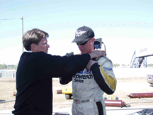 Corvette C5-R Racing driver Johnny O'Connell Putting on HANS Device