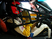 Tests conducted by the GM Racing Safety Program have shown the value of a net inside the vehicle to provide additional support for the seat and driver during an impact.